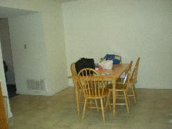 Dining Room in 3 bedroom townhome unit.  Walls throughout are pretty bare.