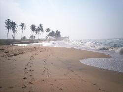 Walking along the beach from Elmina Bay Resort
