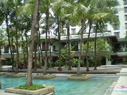 Lush, tropical garden setting, with large pool