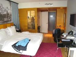 Main sleeping area Hotel Rival showing window from bathroom to the room