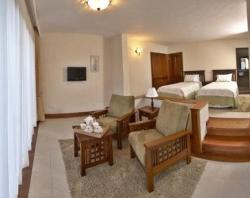 Twin room with sofas for relaxing while viewing the breathtaking view of Lake Naivasha from the