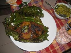 karimeen pollichathu (fish cooked with exotic Kerala spices - delicious!)