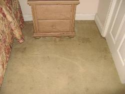 blood stains under end table