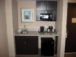 Kitchen area.  Small fridge, no freezer.