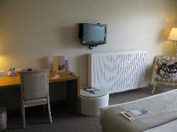 The tiny TV with the super big heating panel for the room