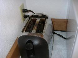 The dirty old toaster in the kitchen.