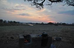 Braai or fire place for cooking with view over Lake Kazuni at sunset