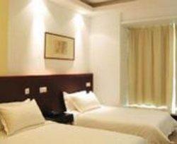 Xinshikong Huiju Apartment Hotel