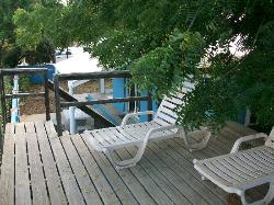 Elevated deck with view of ocean by rental house