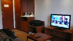 View from the entrance, with a small kitchenette, mini bar, HD TV, safe deposit box (hidden in t