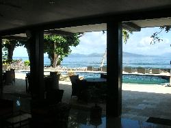 Dining room opens to the pool and ocean!