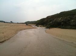 stream that runs into sea