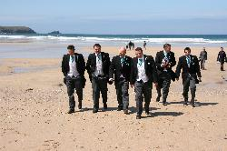 The Groom and Ushers on the beach in Newquay