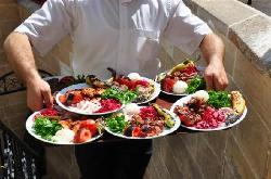 Waiter carrying the meals