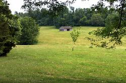 Meadow with stable in the back