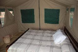 Our Bed and Main tent room (bathroom and shower behind zipped wall in background)