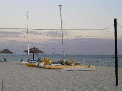 Line up of sea craft on Navini Island beach