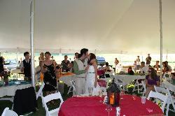 Joyful embrace in reception tent