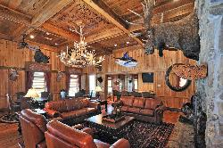 "Heart pine floors, cypress walls, and a magnificent ""pecky-wood"" cypress ceiling adorn the lodge"