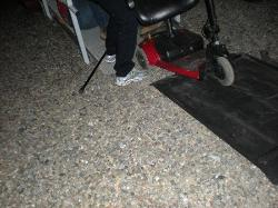 husband fell getting scooter over gravel up ramp