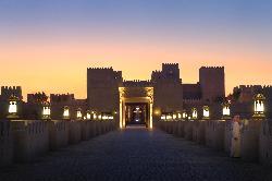 Qasr Al Sarab Desert Resort by Anantara - Flamelit Resort bridge entrance