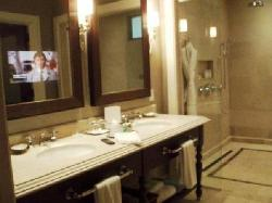 Bathroom with a TV in the mirror!