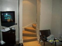 The staircase in the middle of the room