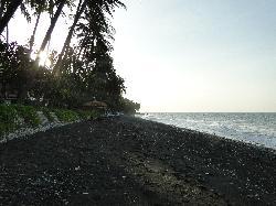 The black volcanic sand beach
