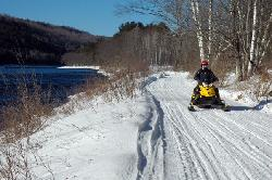 Snowmobiling along the Kennebec River from Northern Outdoors