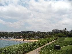 View of hotel along a path by the beach