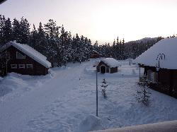 View from balcony of large Immelmokit cabin