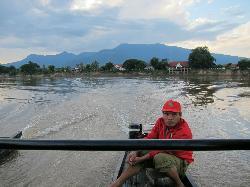 crossing the Mekong to La Folie