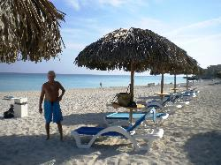 Beautiful beaches, like the new palapas tables,