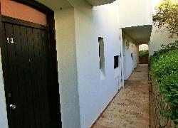 Rückwärtiger Zugang zum Apartment Nr. 13 (Block A 1)