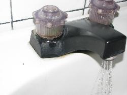 tap base leaks water everywhere when water is turned on.  Something else in need of repair.