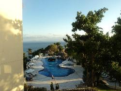 Patio view from room, of pool and ocean