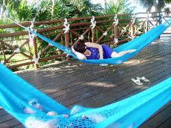 lounging in hammock at beach restaurant