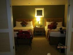 Sleeping area with 2 queen beds and louvered sliding doors to close off from the rest of the sui