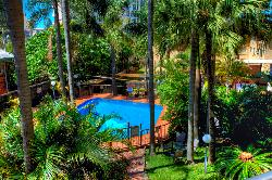 Relax By The Pool At Aristocrat Apartments
