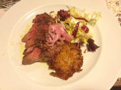 Angus tagliata with sautéd potatoes and salad
