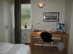 Room with desk and TV