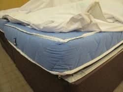 very worn out old mattress pad was 4 inches deep and too hard to sleep on