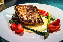 Citrus Brined Arctic Char served with Rosemary-Orange Hollandaise and locally farmed vegetables