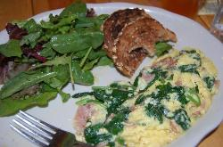 Prosciutto scramble with salad and toast