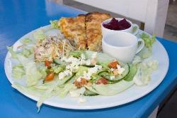 Quiche served with salad, cole slaw and beets