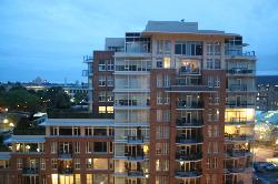 night view of condo tower across the street