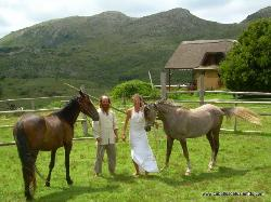 The owners with their house in the background