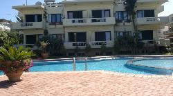 view from pool area of apartments