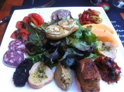 My favorite lunch: Assiette provencal with grilled goat cheese, pate, dried sausage, tapenade, a