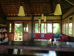 Communal dining area, with more tables facing the view.